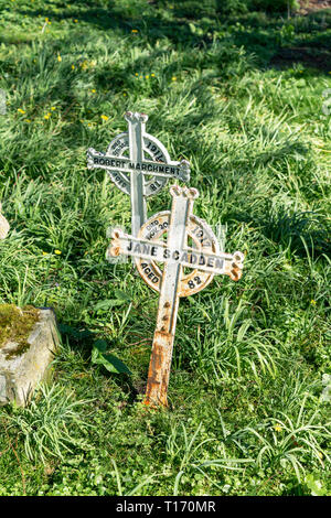 Old metal grave markers - Stock Image