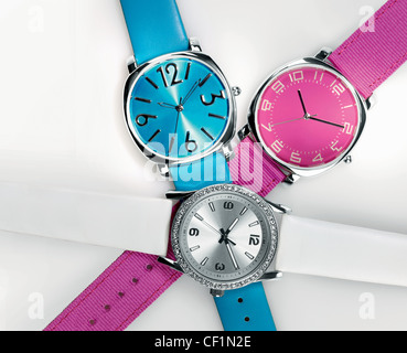 A still life shot of three funky bright watches - Stock Image