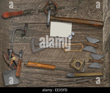 vintage jeweler tools and diamonds over wooden bench, blank card for your business - Stock Image