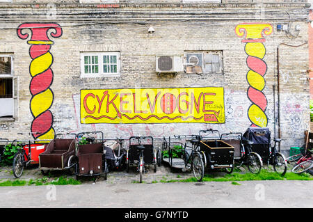 Bicycles parked in a cycle park in Freetown Christiania, Copenhagen. - Stock Image