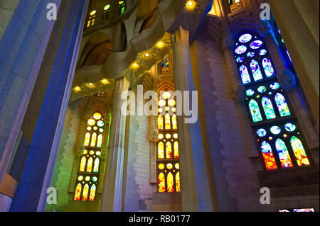 Stained glass of the Sagrada familia designed by Antoni Gaudi, Barcelona, Spain - Stock Image
