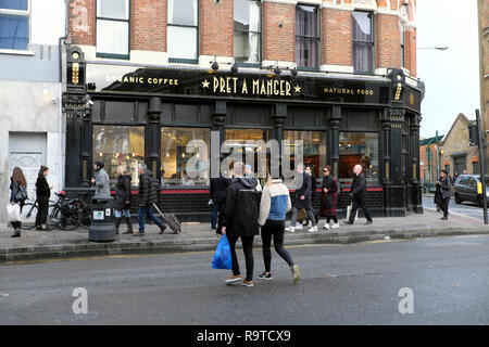 Exterior street view of pedestrians crossing the road outside Pret a Manger Shoreditch East London E2 England UK KATHY DEWITT - Stock Image