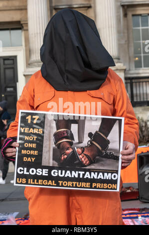 London, UK. 11th January 2019. Members of the Guantanamo Justice Campaign, London Guantanamo Campaign & others mark the 17th anniversary of the first prisoners arriving at the illegal US camp with a display of poster, photographs of the remaining detainees, readings and speeches in Trafalgar Square to highlight the abuse, torture, lack of human rights, force-feeding and indefinite detention there and call for its closure. Credit: Peter Marshall/Alamy Live News - Stock Image
