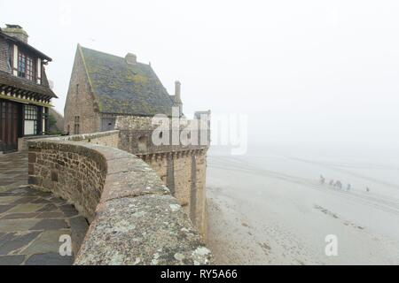 France, Manche, bay of Mont Saint Michel listed as World Heritage by UNESCO, fortification along the rampart stroll in Mont Saint Michel - Stock Image