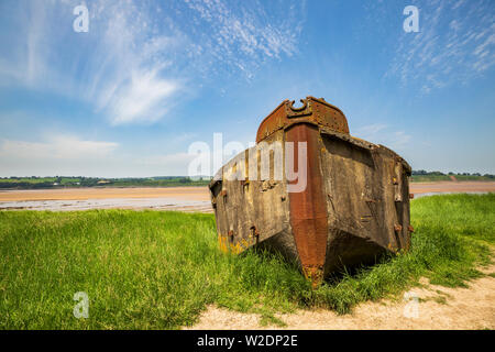 A beached Ferrocement Barge on the banks of the River Severn, part of the Purton Hulks, Gloucestershire, England - Stock Image