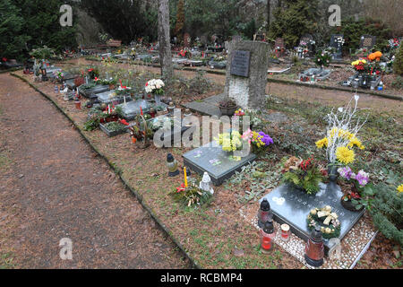 Jan Palach's grave at Prague's Olsany cemetery became a symbol of resistance against the occupiers and so it was guarded by secret police officers to prevent people from approaching it. In 1974, Palach's remains were exhumed and moved to the family grave (on the January 9, 2019, photo) at cemetery in his home town of Vsetaty, central Bohemia, Czech Republic. Nonetheless, there were many who defied the authorities and placed flowers on his grave in Vsetaty, and at the statue of St. Wenceslas on the anniversary of the event. Palach's remains were returned to the Olsany cemetery in 1990, after th - Stock Image