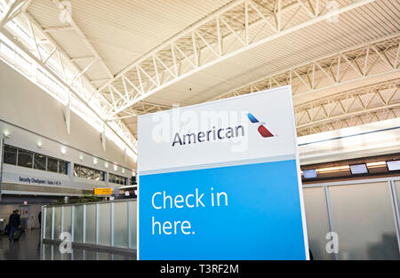 JFK airport American Airlines terminal 8 Check in sign - Stock Image