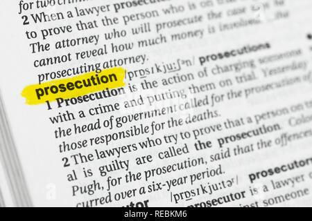 Highlighted English word 'prosecution' and its definition at the dictionary. - Stock Image