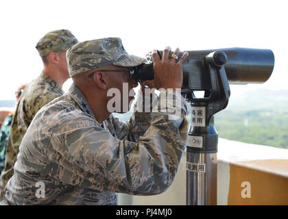 Gen. CQ Brown, Jr., Pacific Air Forces commander, looks into the Democratic People's Republic of Korea from the Dora Observatory near the Korean Demilitarized Zone August 26, 2018. Gen. Brown's trip included stops at the Joint Service Area and Camp Red Cloud, home to the U.S. Army's 2nd Infantry Division. (U.S. Air Force photo by Airman 1st Class Ilyana Escalona) - Stock Image