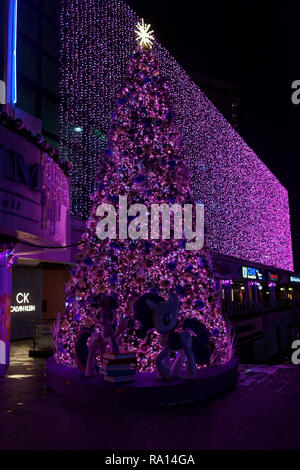 Christmas tree lit up along Orchard Road, Singapore, with the Disney theme - Stock Image