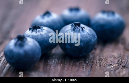 Group of fresh blueberries on natural surface - Stock Image