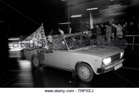 Czechoslovakia, Prague,1989 during the Velvet Revolution, the fall of communism in Eastern Europe. Celebrating the fall of the communist government by driving around Wenceslas Square showing the Czech flag. The white dots are rain and snow falling. COPYRIGHT PHOTOGRAPH BY BRIAN HARRIS  © 07808-579804 - Stock Image