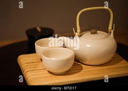 Japanese tea set on a bamboo tray - Stock Image