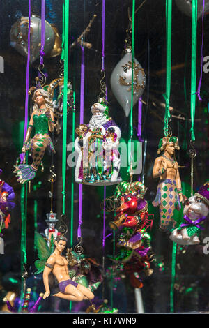 Mardi Gras New Orleans, view of a shop window display of Mardi Gras dolls and trinkets in the center of the French Quarter (VIeux Carre), New Orleans. - Stock Image