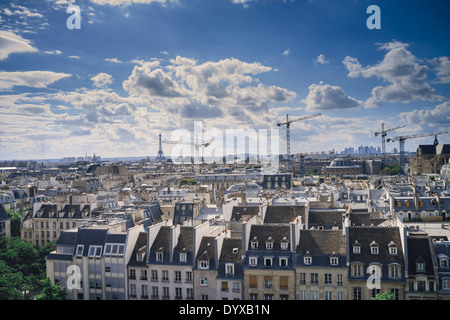 View of the Paris rooftops with Eiffel Tower in the distance in the city of Paris, France. - Stock Image