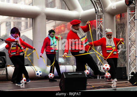 London, UK, 10 February, 2019. Chinese New year celebration at China Town, SOHO, London, UK. Group perfromance by Chinese females on stage. Credit: Harishkumar Shah/Alamy Live News - Stock Image
