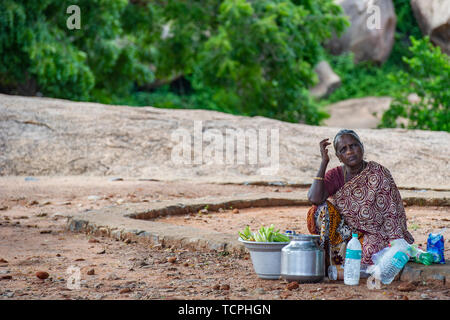 Poverty in Chennai, India, where street stalls and street sellers on the side of the road are common - Stock Image