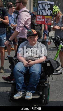 London, UK. 13th July 2018. Anti trump demonstration disabled demontrator - Stock Image