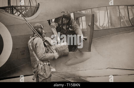 Flight crews with an Avro Anson (named after British Admiral George Anson) a British twin-engined, multi-role aircraft that served with the Royal Air Force (RAF) and Fleet Air Arm (FAA) during the Second World War. It was developed during the mid-1930s in response to a request for tenders issued by the British Air Ministry for a maritime reconnaissance aircraft. Initially used for maritime reconnaissance operation alongside the larger flying boats it was soon found to have become obsolete in front line combat roles and put to use as a multi-engined aircrew trainer. - Stock Image