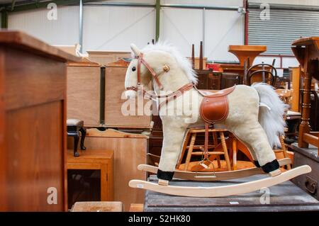 Toy horse for sale in an auction - Stock Image
