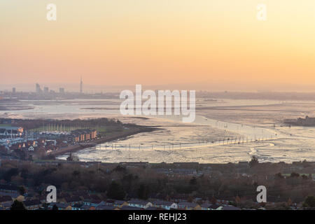 View from Portsdown Hill at dusk over Paulsgrove Lake and Port Solent and the Spnnaker Tower in the distance, Portsmouth, Hampshire, UK - Stock Image