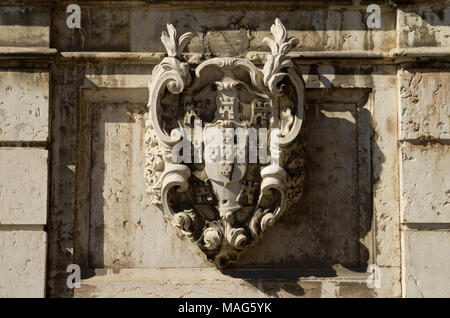 Central high relief panel of Kings fountain monument (Chafariz Del Rei) portraying portuguese symbols and coat of arms. The Kings fountain was built i - Stock Image