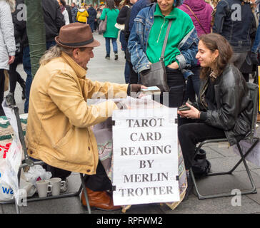 Man doing Tarot card reading for a woman  in central London England UK - Stock Image