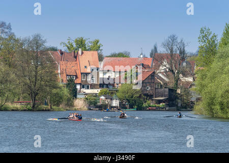 Rowing clubs celebrate the start of the rowing season, all kinds of boats  active, rowing on river Aller, half-timbered - Stock Image