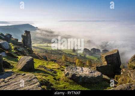 Part finished millstones lie abandoned at the top of Curbar Edge, Derbyshire. - Stock Image