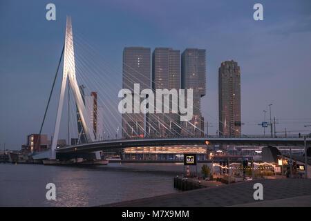 Erasmusbrug (Erasmus Bridge) and De Rotterdam buildings city skyline at twilight, Rotterdam, The Netherlands. - Stock Image