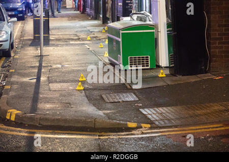 Leeds, UK - 19 November 2018.  Police investigators and forensic teams at the scene of a serious assault on Roundhay Road this afternoon. WYP confirmed man receiving treatment for serious injuries. Credit: James Copeland/Alamy Live News - Stock Image