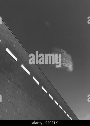 Abstract lines on a building and a cloud. - Stock Image