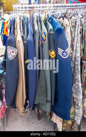 Canadian uniform jackets on sale on a sidewalk in Kensington Market in downtown Toronto, Ontario, Canada - Stock Image