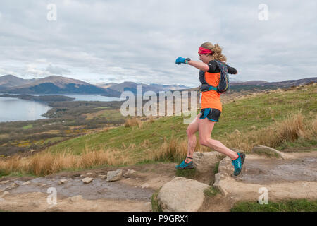 Female trail runner and eventual ladies winner Rachel Normand descending Conic Hill during the Highland Fling ultra marathon race in 2018 - Stock Image