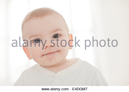 Close up of smiling baby - Stock Image