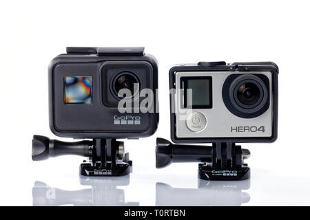 The 7 Black and 4 silver GoPro Hero models isolated on white. - Stock Image