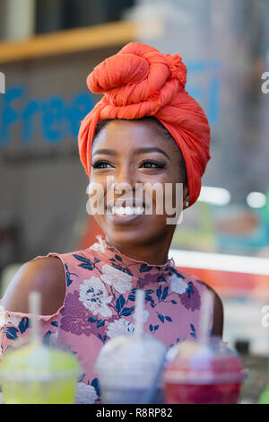 Smiling young woman wearing headscarf - Stock Image