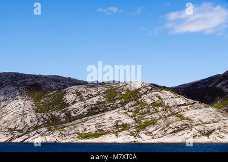 Glacial striations or scratches on rocks in a Norwegian fjord in the Arctic. Nordland, Norway, Scandinavia, Europe - Stock Image