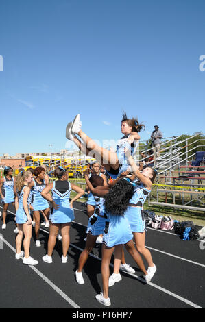 cheerleaders perform at a football game in Greenbelt, Maryland - Stock Image