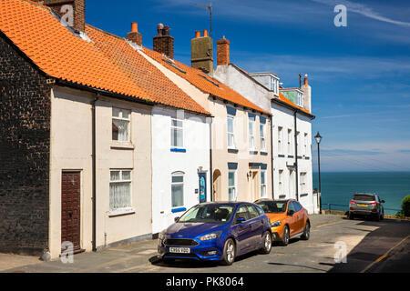 UK, England, Yorkshire, Filey, Queen Street, old fishermen's cottages overlooking sea - Stock Image
