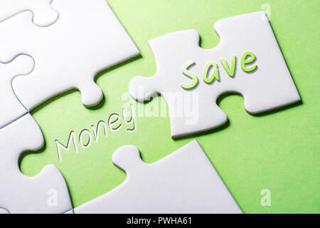 The Words Save And Money In Missing Piece Jigsaw Puzzle - Stock Image
