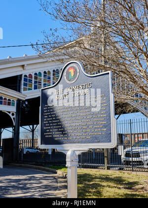 Slave trade historical marker describing the treatment of slaves in the 1800's during the height of the slave trade in Montgomery, Alabama USA. - Stock Image