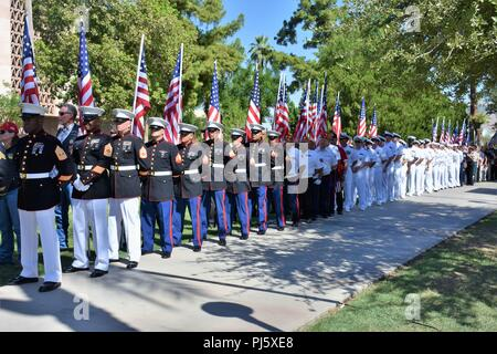 Marine and Navy recruiters stand at parade rest as they wait for the casket containing Sen. John McCain's remains, to be laid in the Arizona State Capitol, Aug. 29, Phoenix. (U.S. Army Photo by Alun Thomas, USAREC Public Affairs) - Stock Image