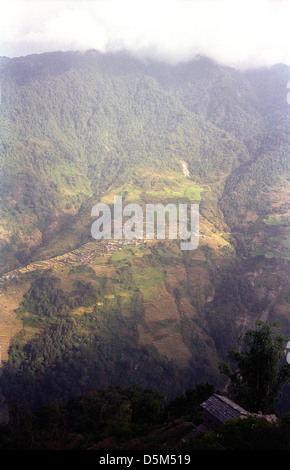 Typical village settlement with terraced farms in Modi Khola valley near Chomrong Annapurna circuit Nepal Himalayas - Stock Image