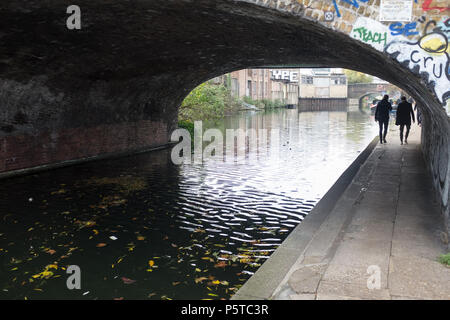 People Walking Under Tunnel Alongside Canal, Hackney, London, England, UK. - Stock Image