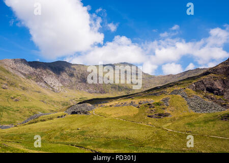 View to Mt Snowdon across Cwm Llan with Watkin Path passing remains of slate quarries in Snowdonia National Park. Bethania Gwynedd Wales UK Britain - Stock Image