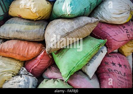 Colorful sacks in a pile - Stock Image