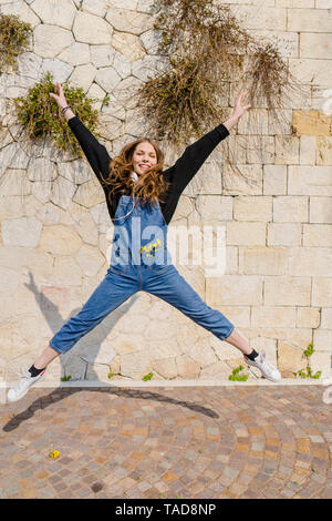Young woman jumping in Verona - Stock Image