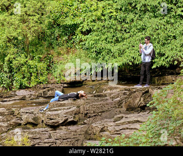 New Lanark, Scotland, UK 6th July, 2019. UK Weather: Warm weather for the new Lanark world heritage centre and the falls of Clyde Scottish wildlife trust trail as locals and tourists take to the paths to view the waterfalls of the Clyde. Credit: Gerard Ferry/ Alamy Live News - Stock Image