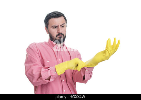 Cleaning man putting latex glove and prepare to clean house isolated on white background - Stock Image